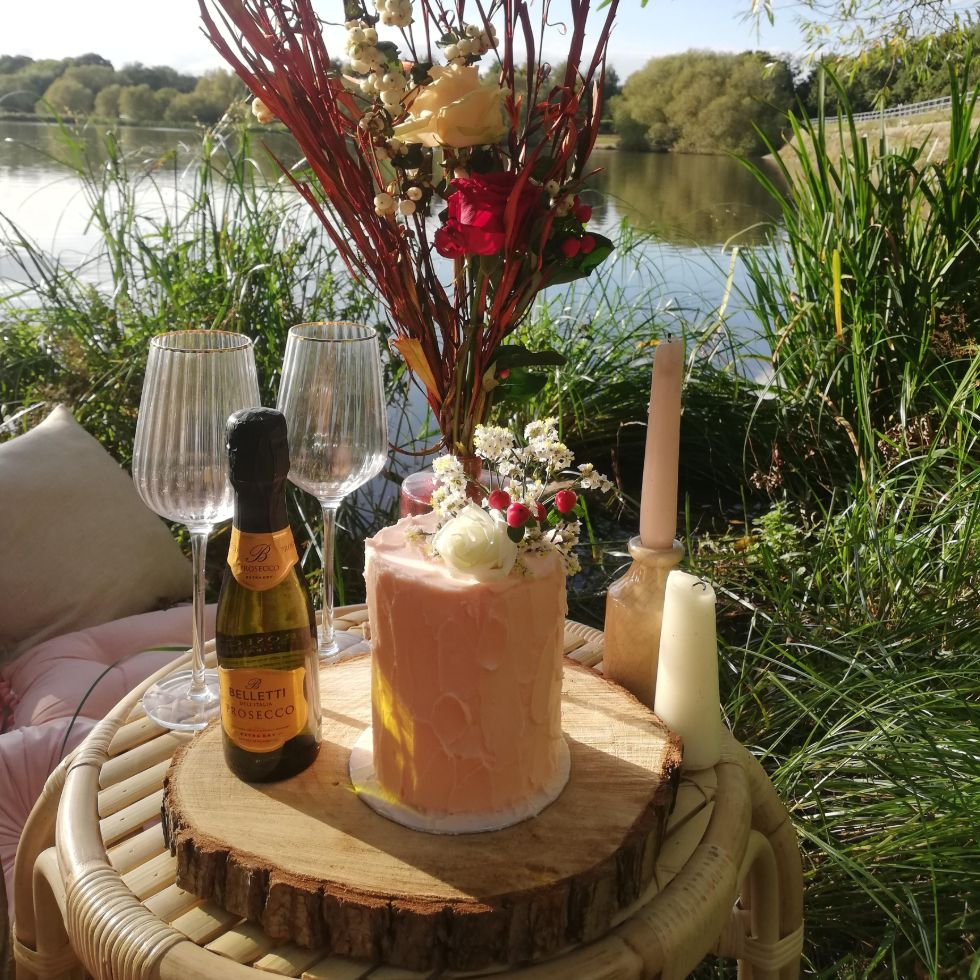 outdoor picnic for two with prosecco and mini wedding cake